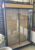 A shop display cabinet, width 128cm, depth 39cm, height 203cm