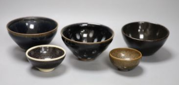 Five Chinese tenmoku glazed bowls, tallest 7cmCONDITION: Structurally good; one dish with
