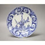 An 18th century Japanese Arita blue and white plate, spurs marks, diameter 26cmCONDITION: Repaired