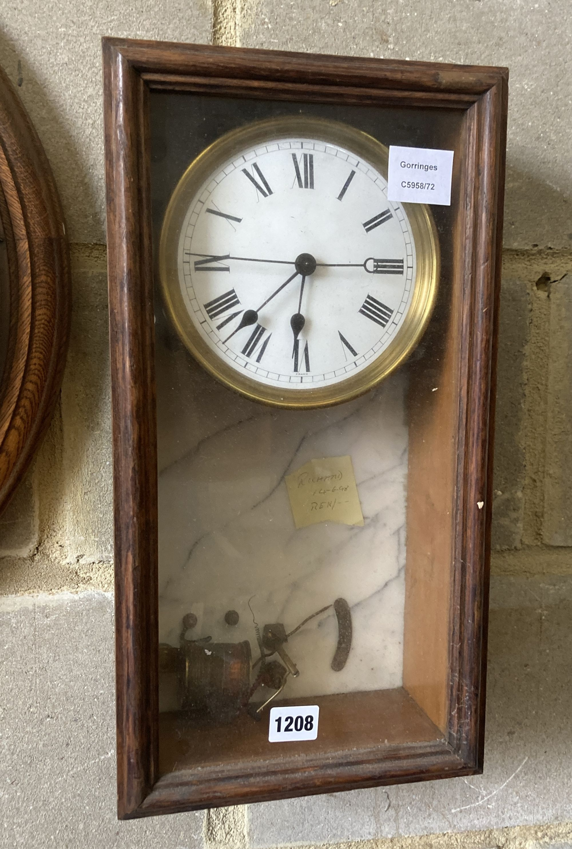 A Brillie oak and marble electric wall clock