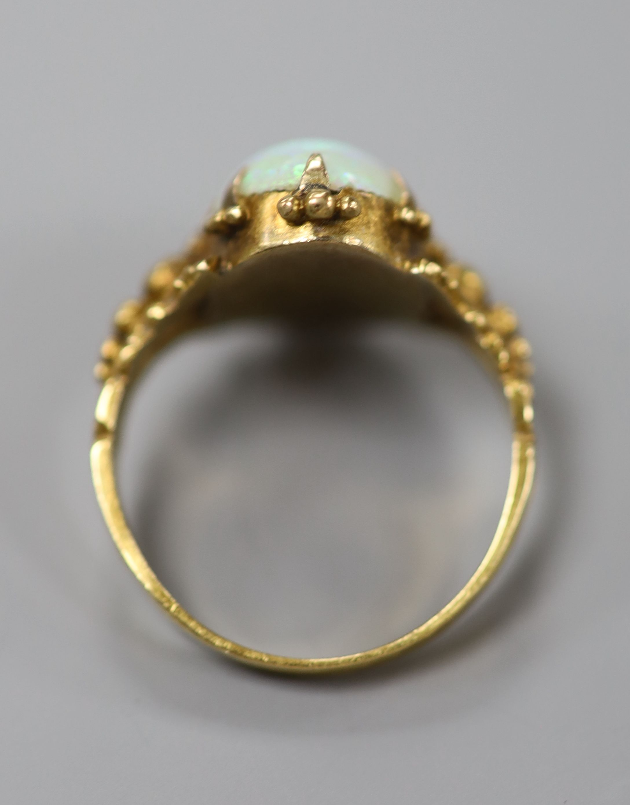 A 19th century yellow metal and oval white opal set dress ring, size M, gross 4.1 grams.CONDITION: - Image 3 of 3