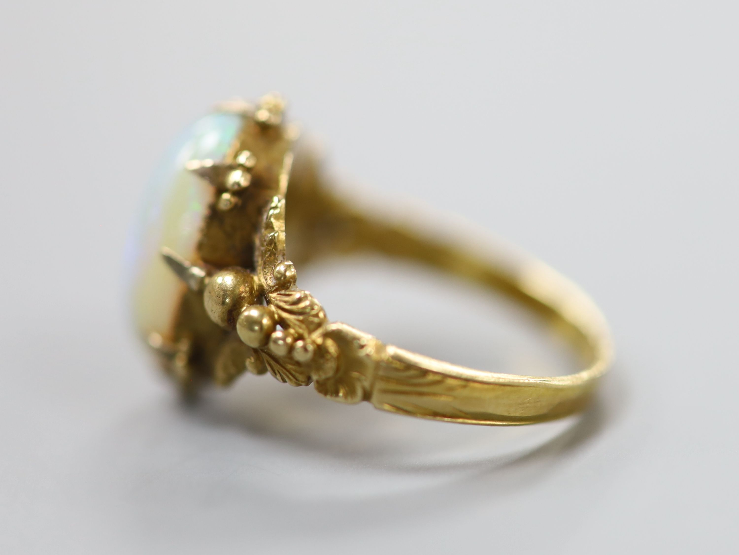 A 19th century yellow metal and oval white opal set dress ring, size M, gross 4.1 grams.CONDITION: - Image 2 of 3