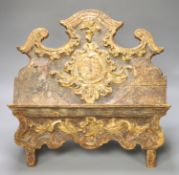 An 18th century Spanish carved and gilded book stand, width 42cm height 37cm