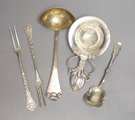 A stylish early 20th century Danish white metal tea strainer, 14.7cm and four other similar items of