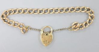 A 9ct gold curblink bracelet, with heart shaped padlock clasp, approx. 17cm, gross 9.5 grams.