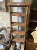 A four tread oak ladder, width 42cm, height 130cm