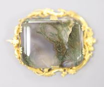 A 19th century yellow metal mounted moss agate brooch, 46mm, gross 12.9 grams.CONDITION: The stone