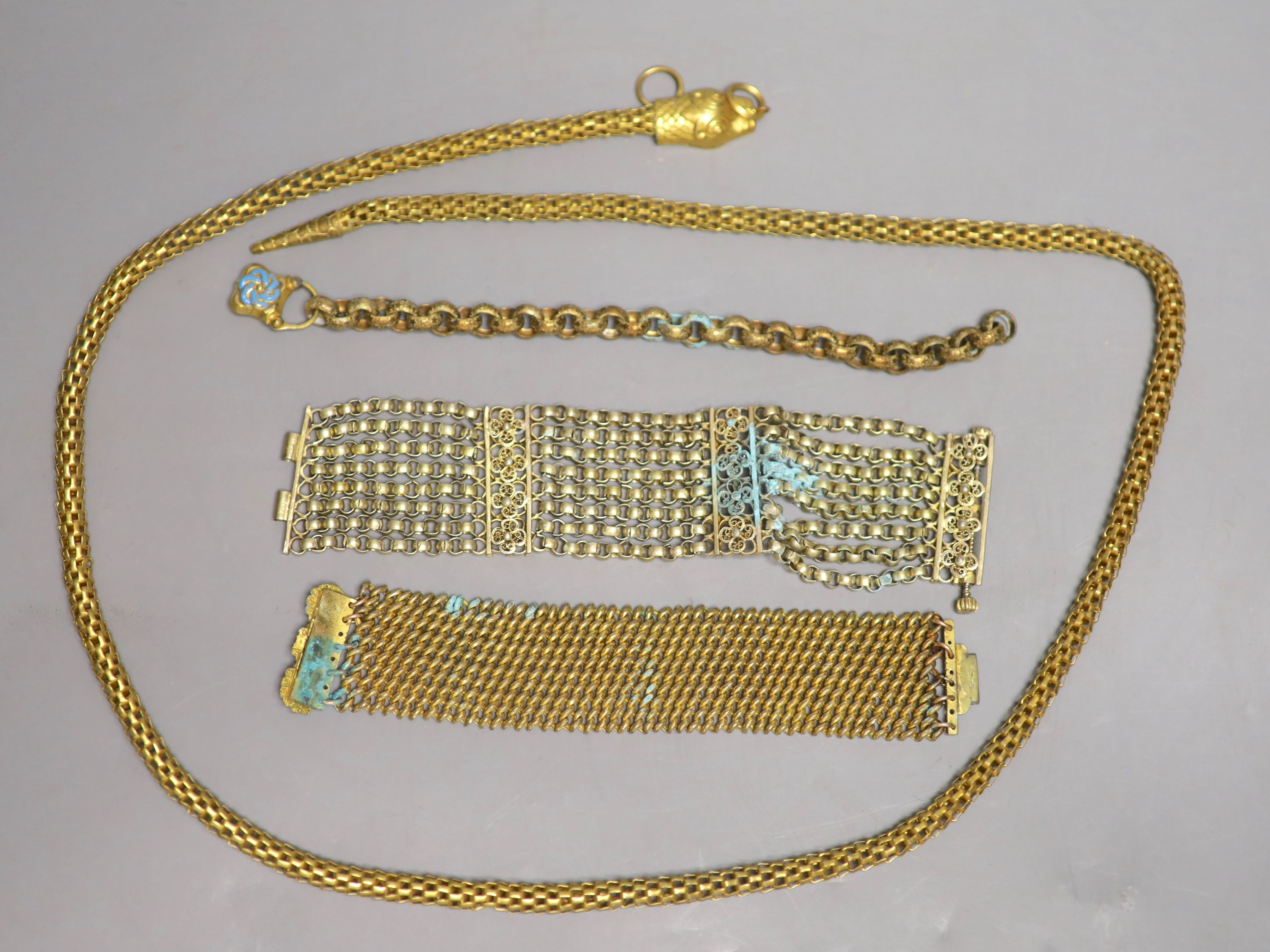 Four items of Victorian pinchbeck jewellery including a serpent necklace, 92cm and three assorted