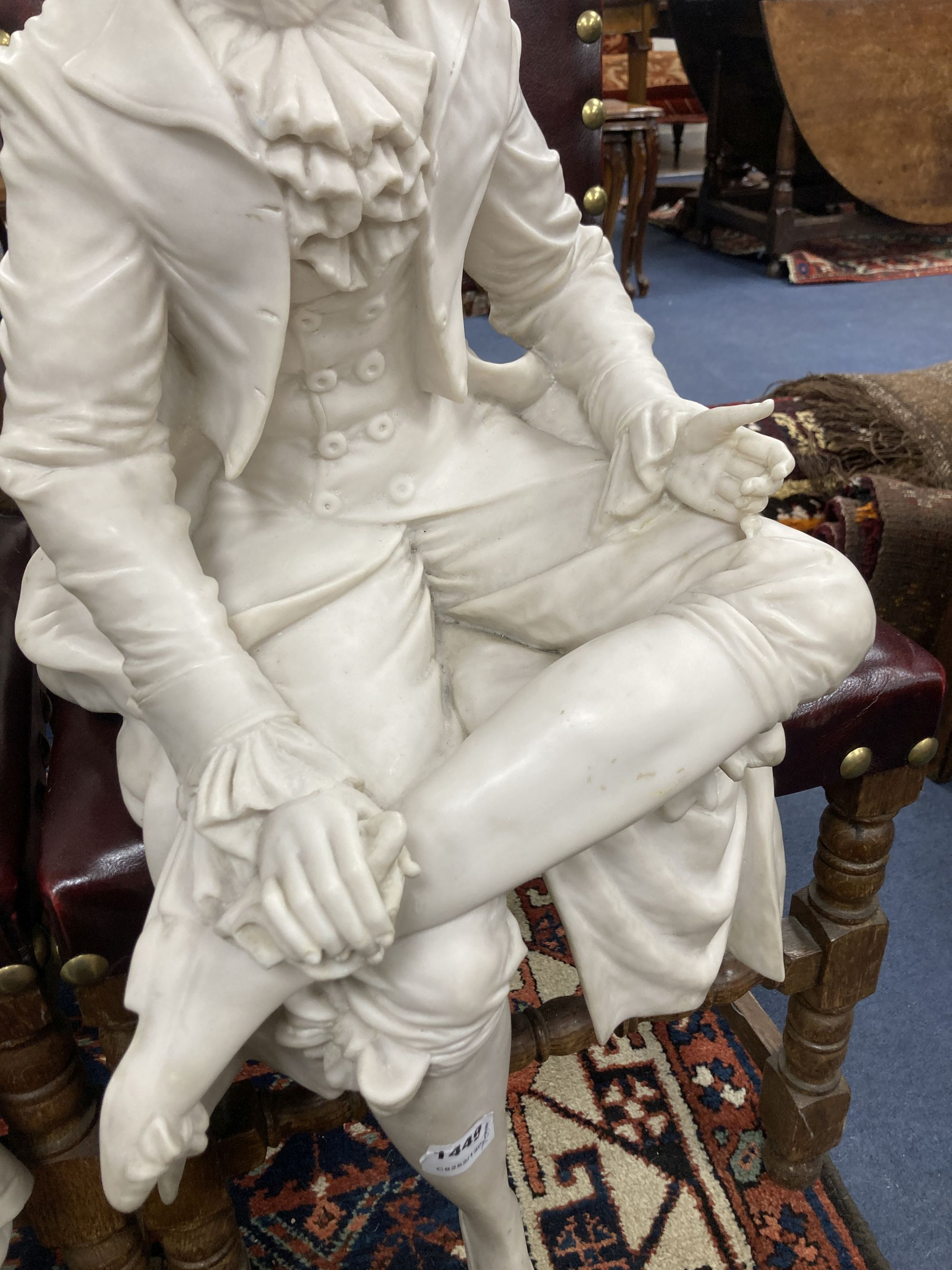 A pair of resin marble seated figures of a Dandy and a Dandizette on ebonised plinths - Image 5 of 7