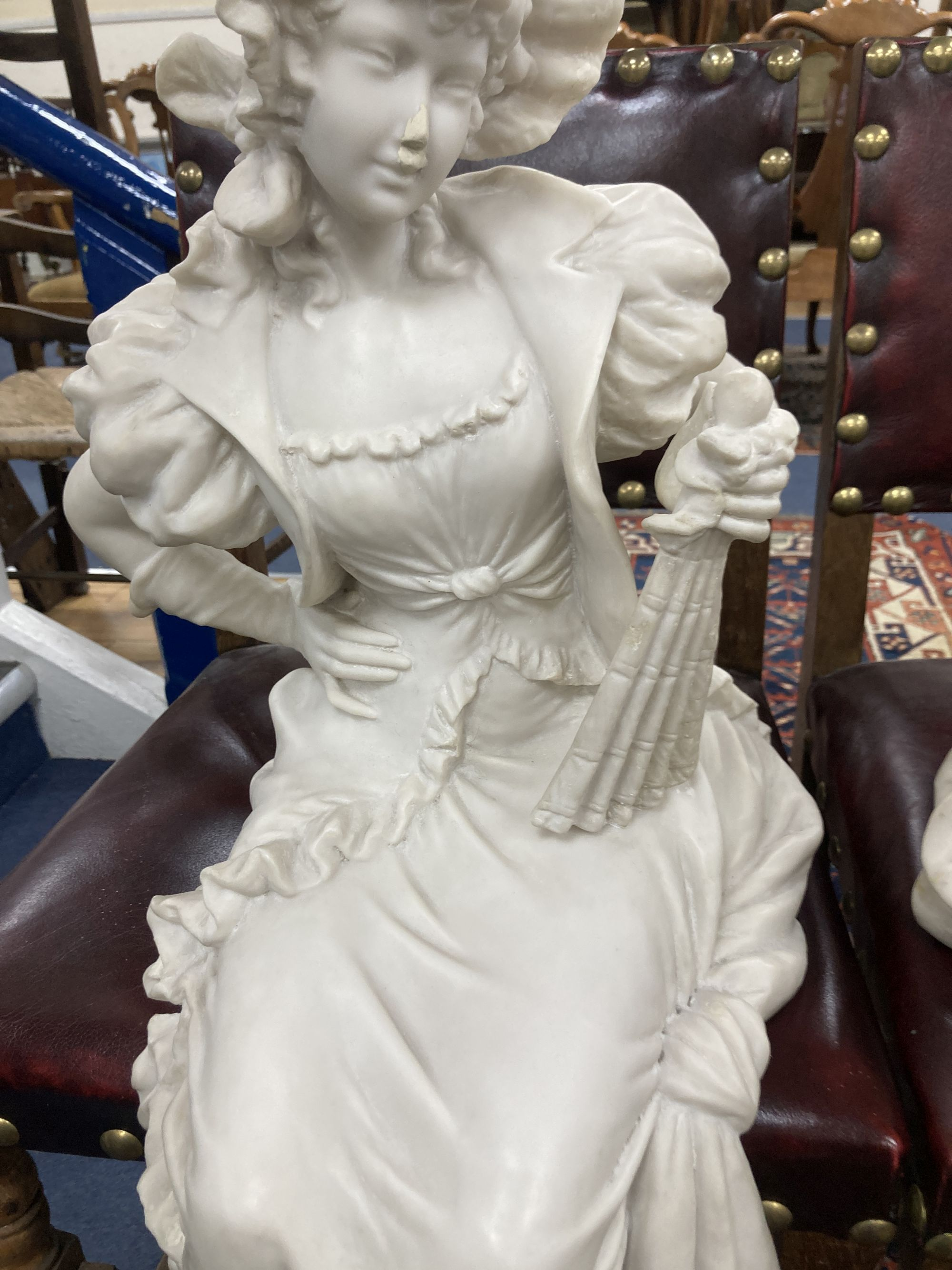 A pair of resin marble seated figures of a Dandy and a Dandizette on ebonised plinths - Image 3 of 7