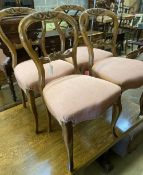 A set of four Victorian walnut balloon back dining chairs