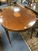 An Edwardian satinwood banded mahogany oval topped centre table, width 106cm, depth 90cm, height