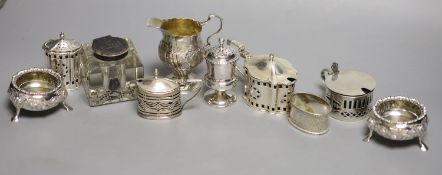 A collection of small silver items, comprising a George III helmet-shaped embossed cream jug, a