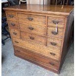 An Edwardian walnut eight drawer chest, width 122cm depth 57cm height 119cm