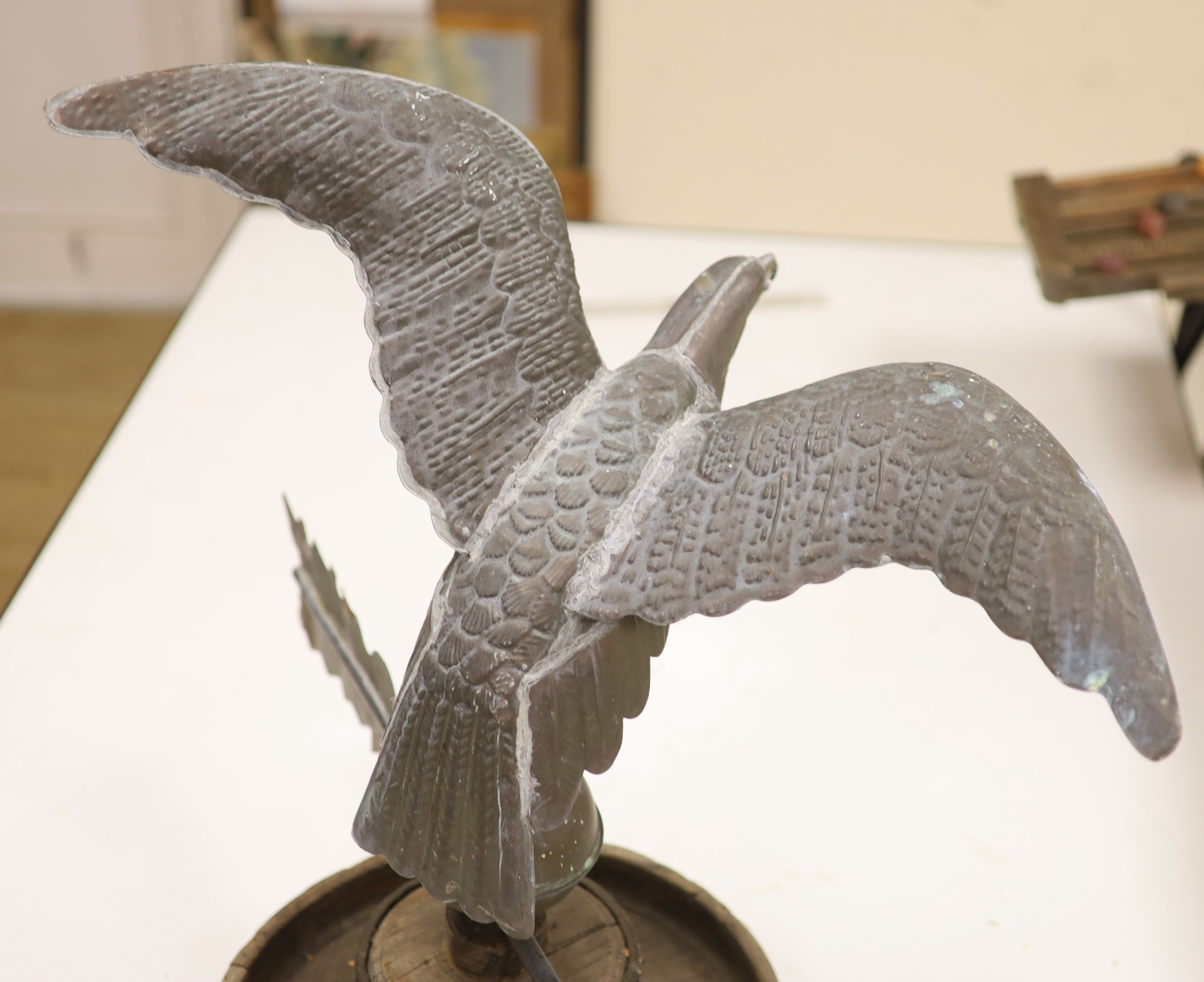 A 19th century American copper weather vane, modelled as an eagle, on an associated wooden base, - Image 6 of 6