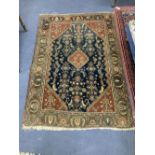 A North West Persian blue ground rug, 164 x 118cm