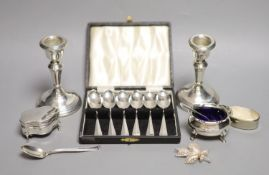 A pair of modern silver dwarf candlesticks, London, 1977, 10.6cm, weighted, two silver condiments,