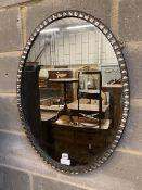 An Irish style oval wall mirror, width 58cm, height 76cm