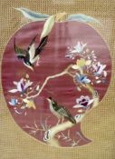 A Japanese silkwork panel of birds on a purple ground, width 48cm to the mounts height 57cm