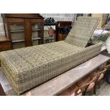 An all weather rattan garden sunlounger with adjustable back, length 210cm, depth 64cm, height 33cm