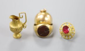 An 18ct and hardstone? set signet ring(a.f.), gross 6.4 grams, a yellow metal spherical hinged