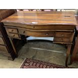 A reproduction mahogany serpentine front writing table, width 106cm depth 57cm height 84cm