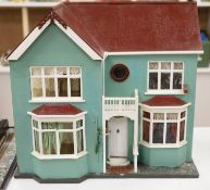 A 1940's doll's house, with contents from Compton Verney Warwickshire, width 63cm height 60cm