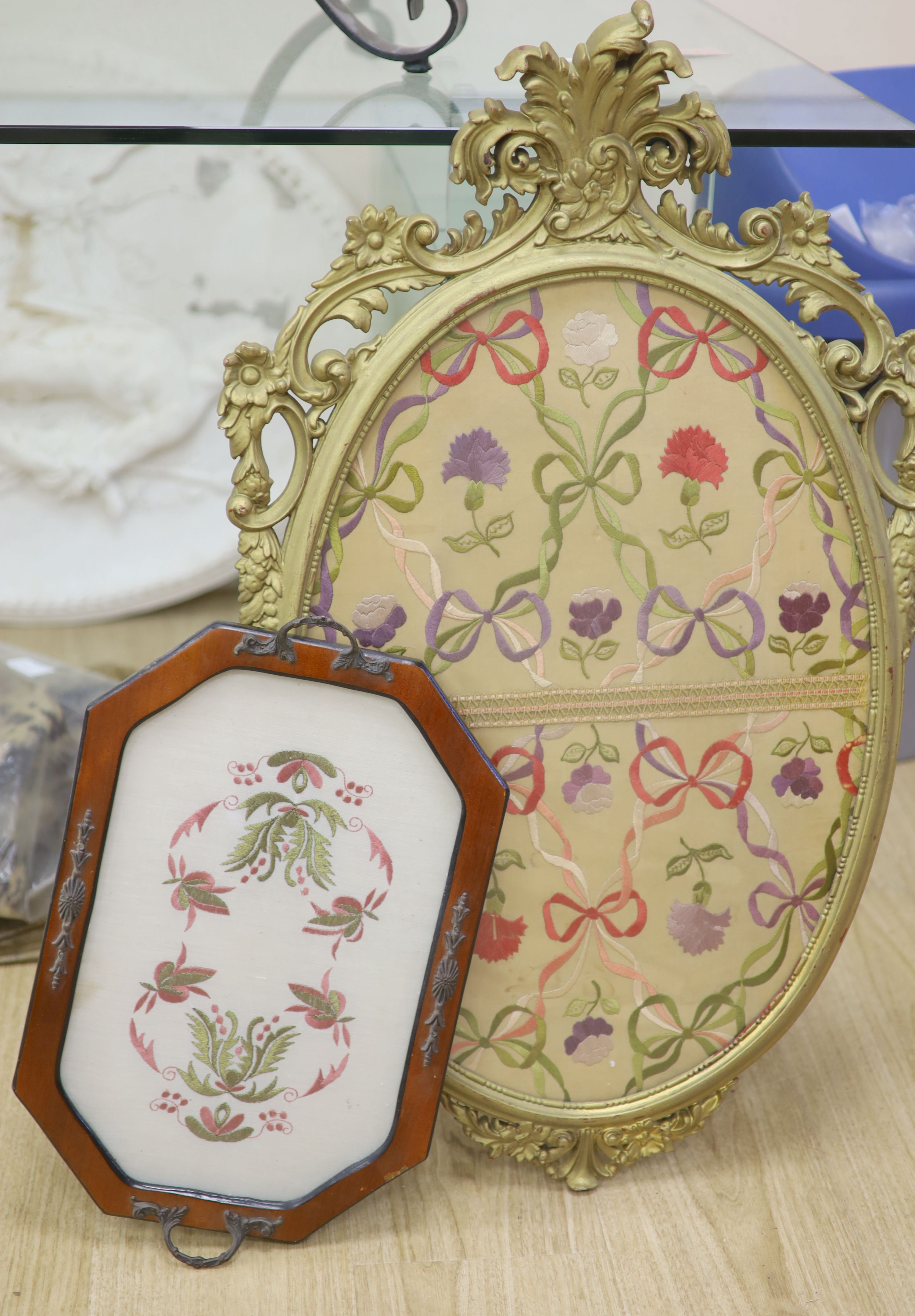 An oval needlework panel and another, largest 39 x 59cm