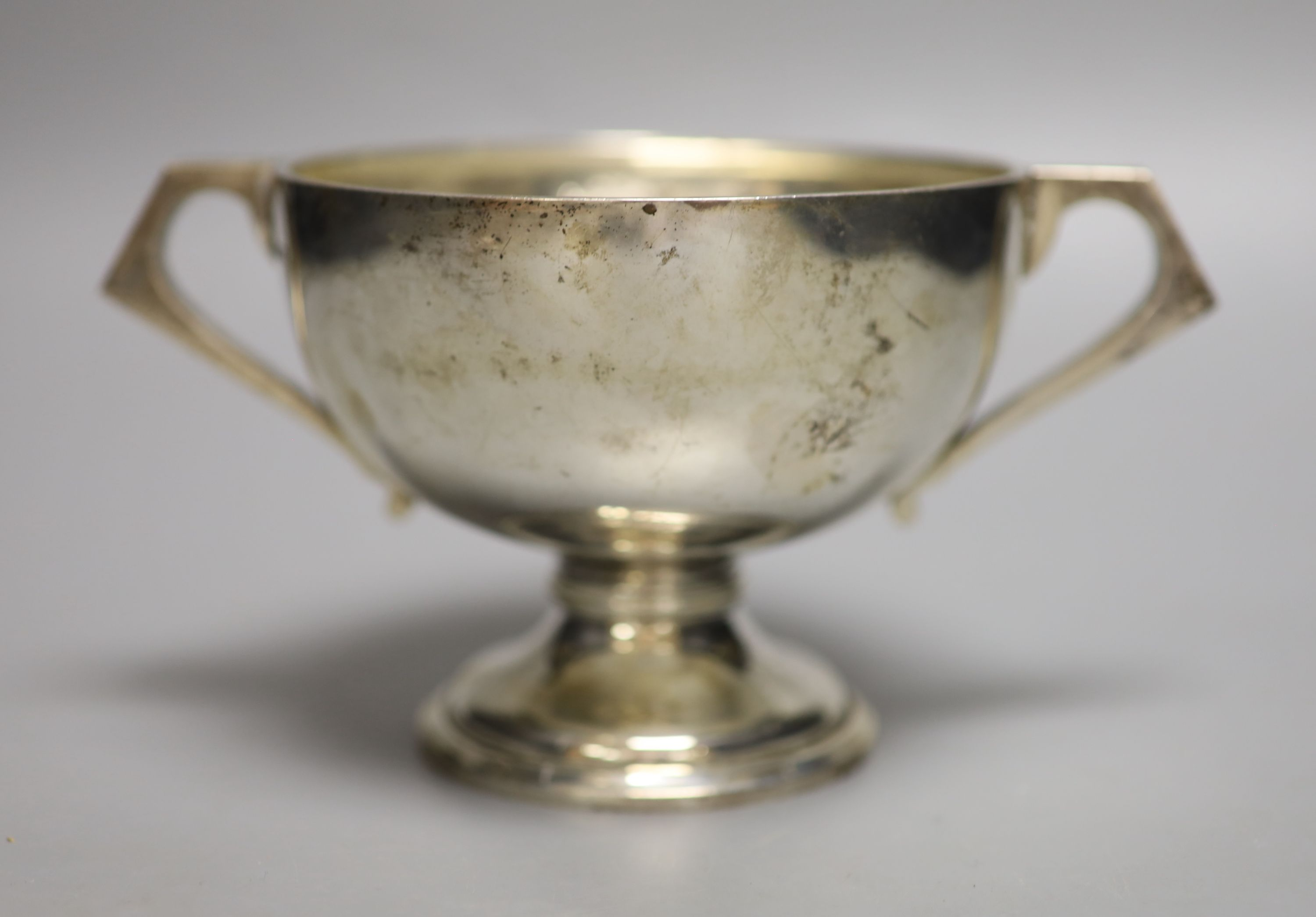 An Anglo-Indian silver two-handled pedestal rose bowl, marked C & K (Cooke & Kelvey), snake and SIL,