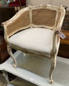 A Louis XVI style painted caned tub framed chair, width 62cm, depth 50cm, height 80cm