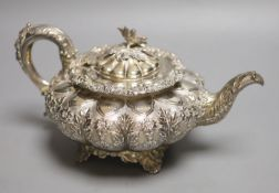 A George IV silver squat melon shaped teapot, embossed with flowers, The Barnards, London, 1829,