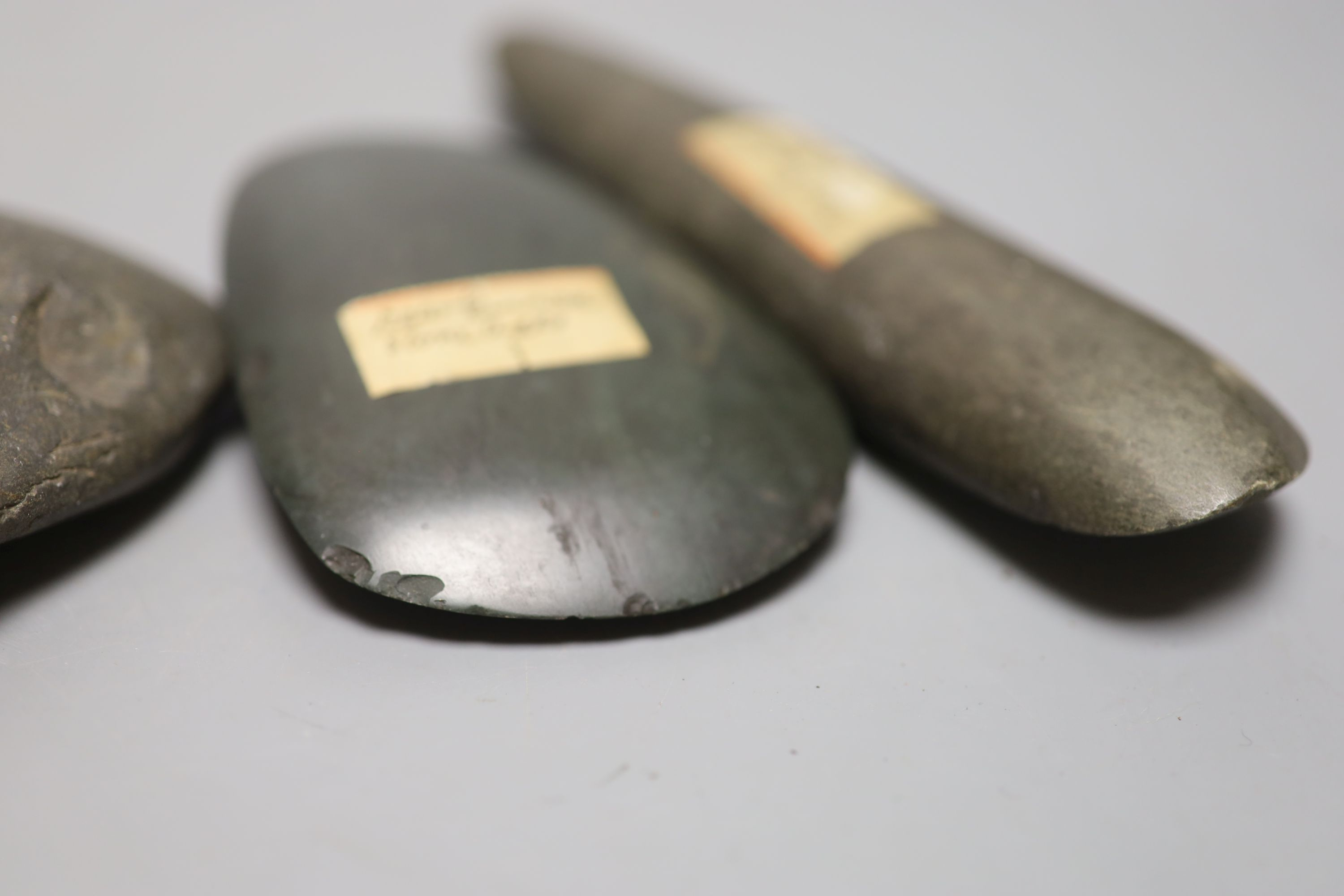 A group of stone adze hand tools, three 19th century Papua New Guinea, each labelled New Guinea, - Image 5 of 6