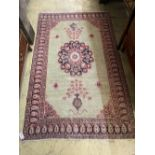 A North West Persian pale green ground rug, 195 x 118cm