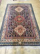 A Caucasian blue ground rug, 220 x 130cm