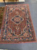 A red ground Shiraz rug, 204 x 132cm