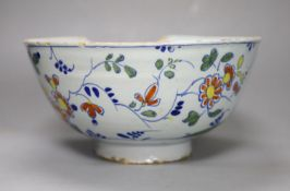 An 18th century English Delft punch bowl, diameter 26cmCONDITION: Bowl - obvious damage includes