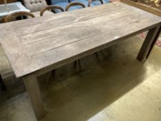 A large rectangular weathered teak garden table, width 220cm, depth 99cm, height 79cm