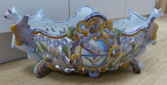 A large French Saint Clement faience centrepiece oval bowl, length 56cmCONDITION: Structurally good;