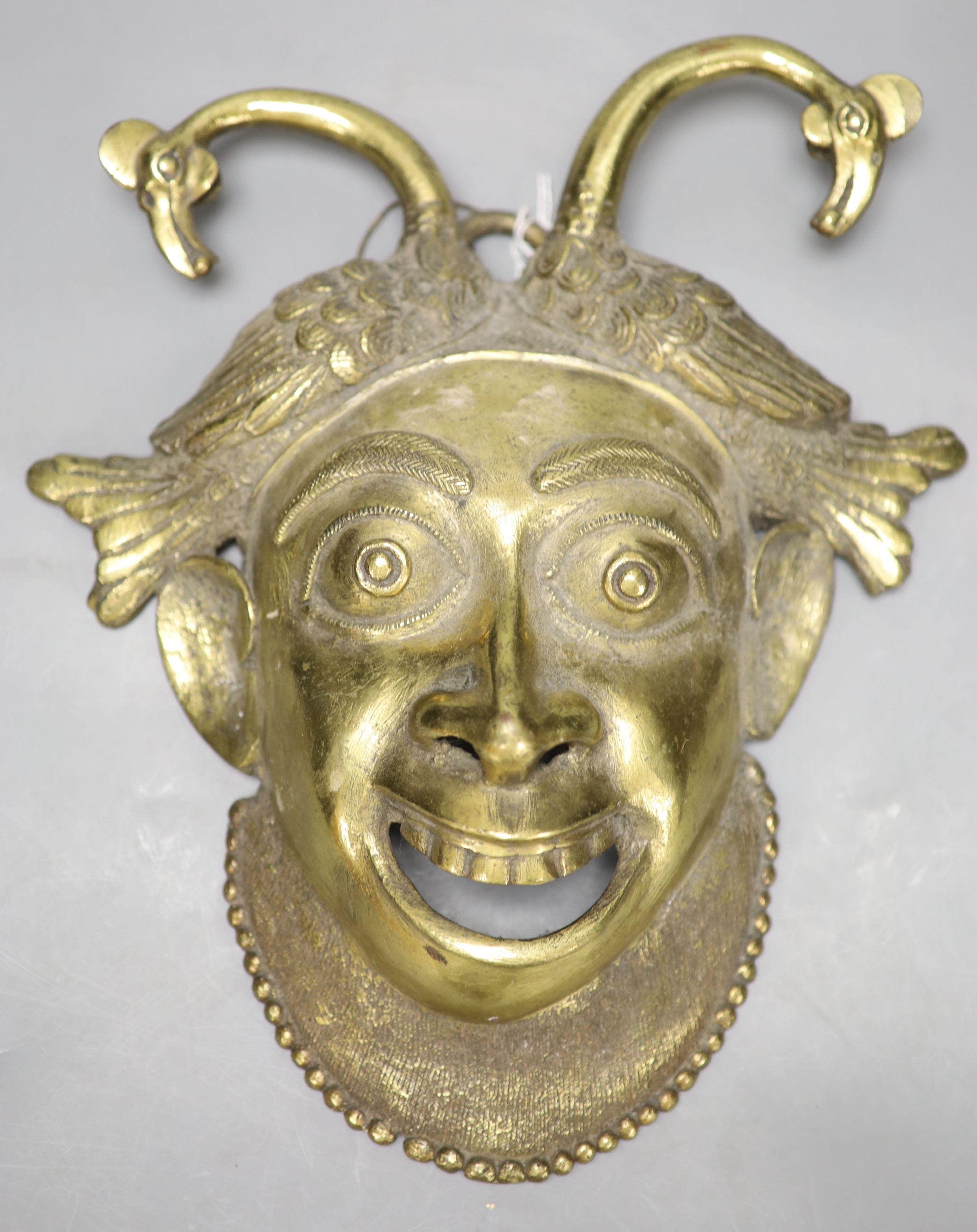 A gilt bronze wall mask, height 33cm