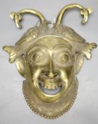A gilt bronze wall mask, height 33cm