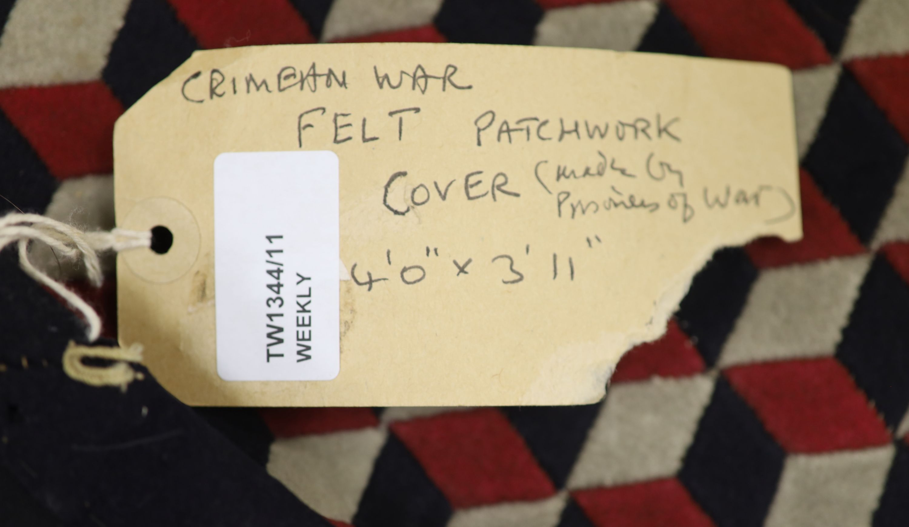A 19th century 'Crimean' patchwork cover, made from military uniform felt in red, white, black and - Image 4 of 4