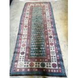 An early 20th century Caucasian hall carpet, 262 x 106cm