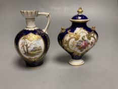 Two Royal Crown Derby vases, tallest 11cm highCONDITION: The single handled vase has discoloured