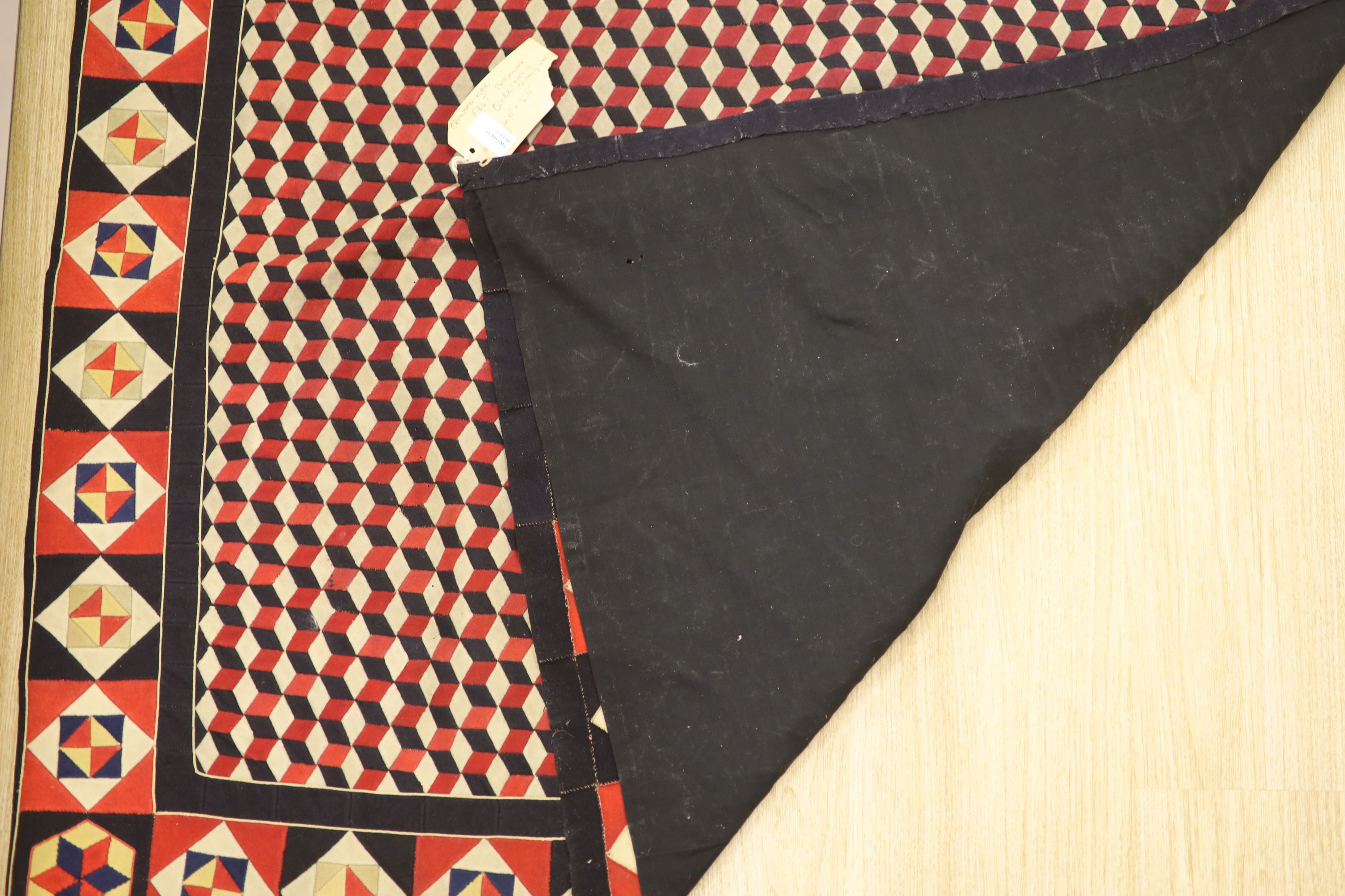 A 19th century 'Crimean' patchwork cover, made from military uniform felt in red, white, black and - Image 3 of 4