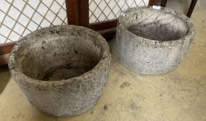 A pair of reconstituted stone circular garden planters, diameter 47cm, height 28cm