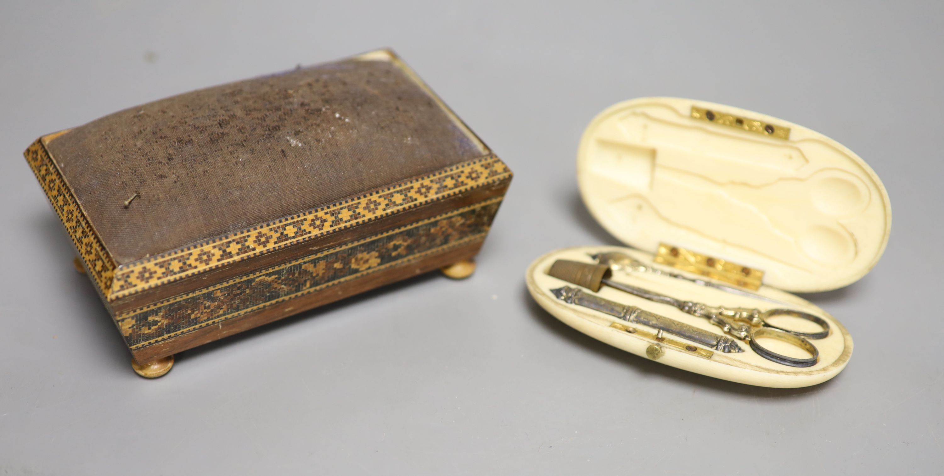 A Tunbridgeware pin cushion and an ivory cased manicure set