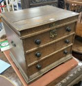 A Queen Anne oak commode, with dummy drawer front, width 46cm, depth 39cm, height 43cm