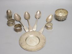 Four assorted 19th century silver fiddle pattern dessert spoons, a silver saucer, two silver