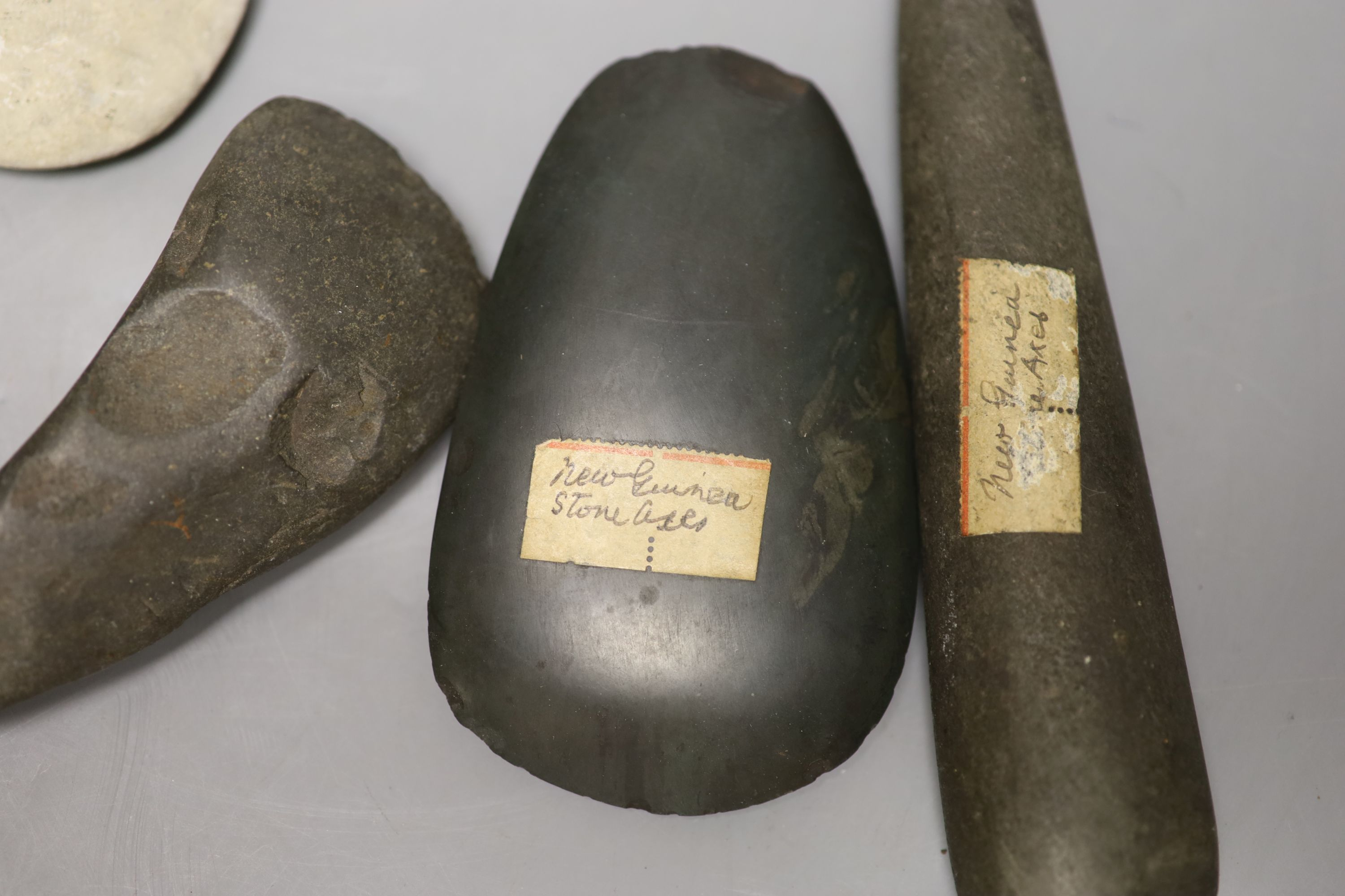 A group of stone adze hand tools, three 19th century Papua New Guinea, each labelled New Guinea, - Image 4 of 6
