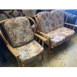 An Ercol style beech two piece lounge suite, settee 116cm, depth 74cm, height 80cmCONDITION: Not